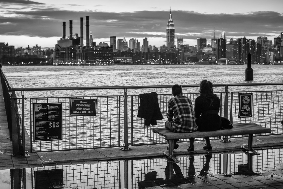 People sitting east river